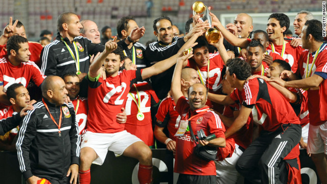 Egypt's Al-Ahly team pose with the African Champions League trophy after winning 2-1 against Esperance de Tunis.