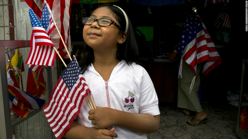 A girl holds American flags that she just purchased at a flag shop as Yangon, Myanmar, prepares for Obama's visit.  Obama will be the first U.S. president to visit Myanmar, also known as Burma, during his four-day tour of Southeast Asia, which will also include visits to Thailand and Cambodia.