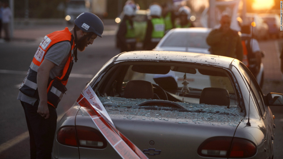 An Israeli emergency worker inspects the damage to a car in Ofakim, Israel, that was hit by a rocket fired by Palestinian militants from the Gaza Strip on Sunday, November 18.