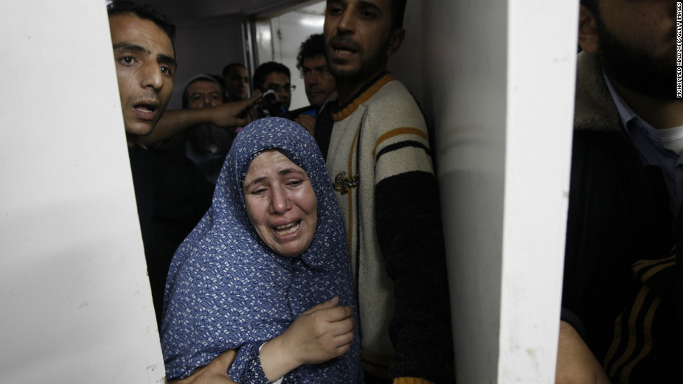 Palestinian relatives grieve at the hospital in Gaza City on Sunday, November 18, over family members killed in an airstrike.
