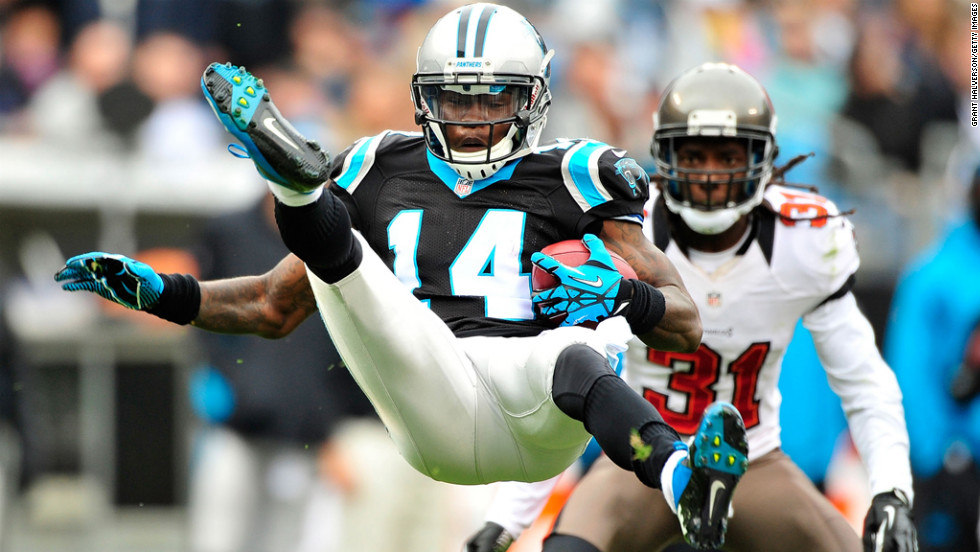 Armanti Edwards of the Panthers is upended by Arrelious Benn of the Buccaneers on a kickoff return on Sunday.