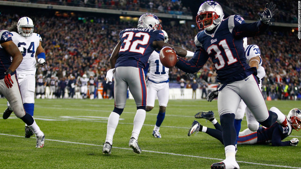 Aqib Talib of the Patriots returns an interception for a touchdown in the first half against the Colts during the game on Sunday.