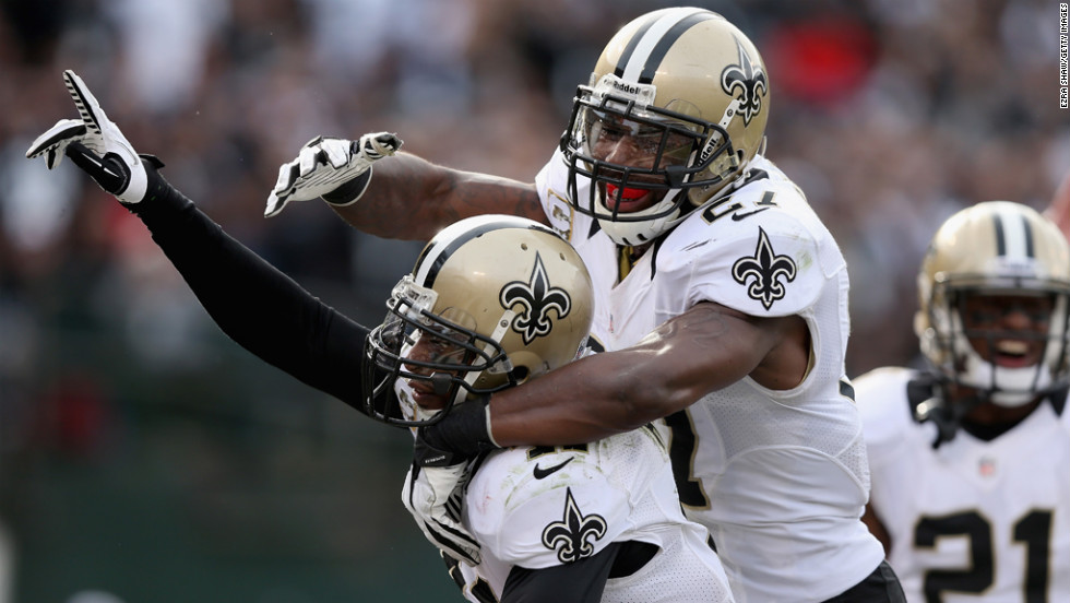 Roman Harper of the Saints is congratulated by Malcolm Jenkins after Harper intercepted the ball in the endzone during their game on Sunday.