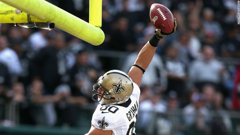 Jimmy Graham of the Saints dunks the ball over the goal posts after he scored a touchdown against the Raiders on Sunday.
