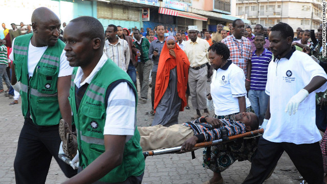A casualty of a suspected bomb attack is carried away by medics from the scene of the attack in Nairobi on Sunday.