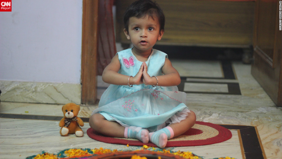 """This is my daughter Kyra doing Goddess Luxmi worship,"" says avid iReporter <a href=""http://ireport.cnn.com/docs/DOC-881017"" target=""_blank"">Manish Kanojia</a> from New Delhi. According to her dad, Kyra thoroughly enjoyed her first ever festival of lights although ""she was slightly scared of the Diwali crackers."""