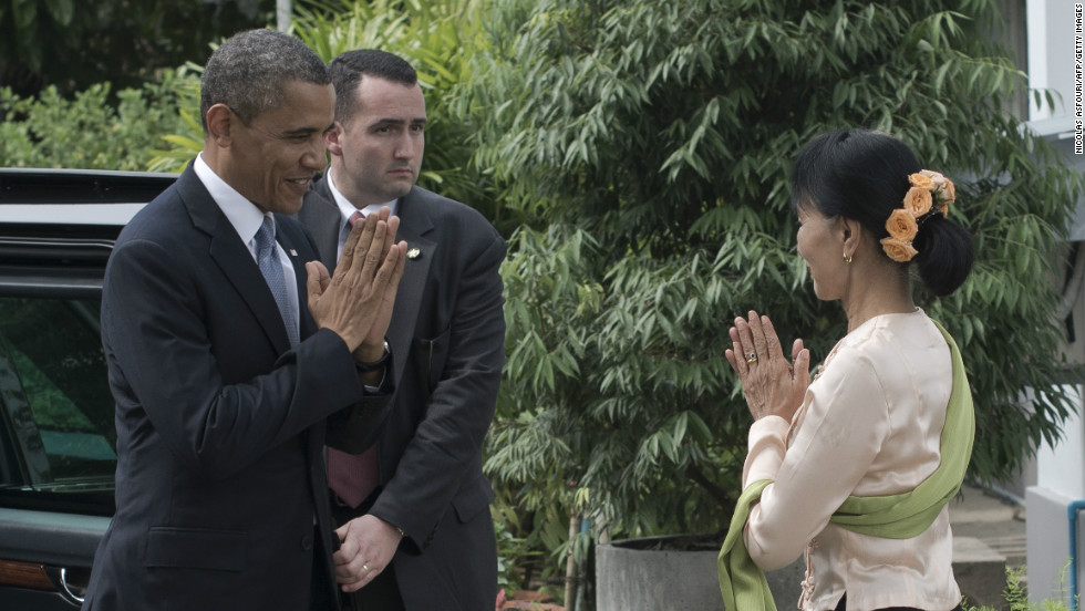 U.S. President Obama  is greeted by Myanmar pro-democracy leader Aung San Suu Kyi at her residence in Yangon on Monday.