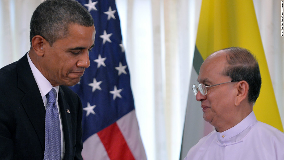 U.S. President Obama shakes hands with Myanmar's President Thein Sein in Yangon on Monday.