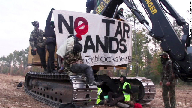 Protesters block equipment Monday at a Keystone XL pipeline construction site in Cherokee County, Texas.