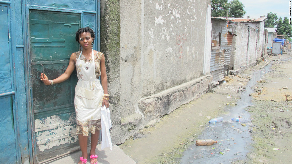 Masamba, like many other members of the orchestra, lives in a typical Kinshasa neighborhood that has unpaved roads and is lined with sewage.