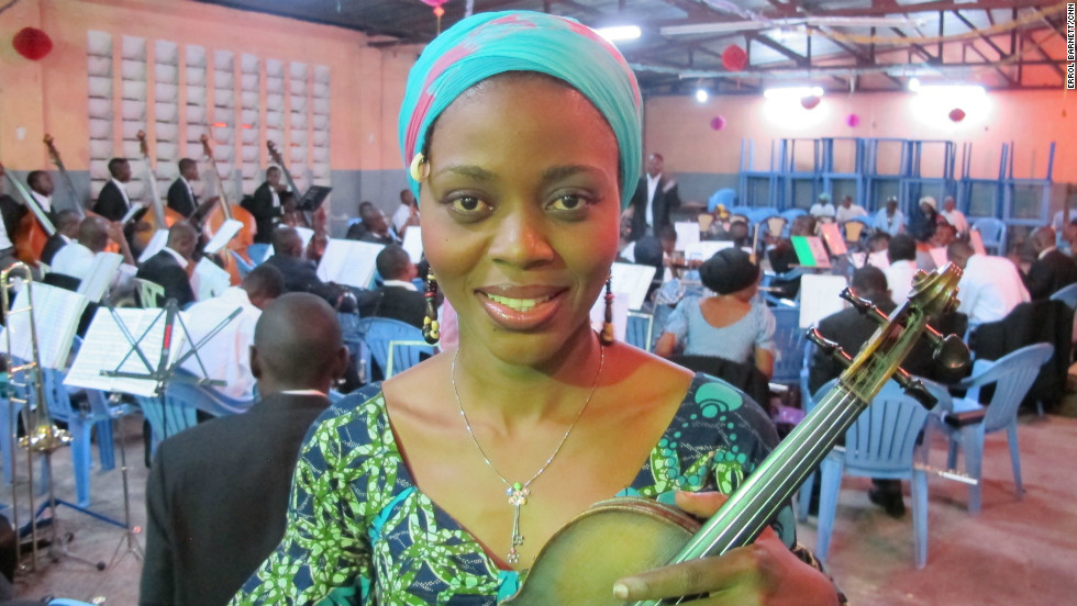 "Violin player Pauleth Masamba has been playing with the Orchestre Symphonique Kimbanguiste since the mid-1990s. ""Music is one of the things that comforts me, takes off the stress and makes me happy,"" she says."