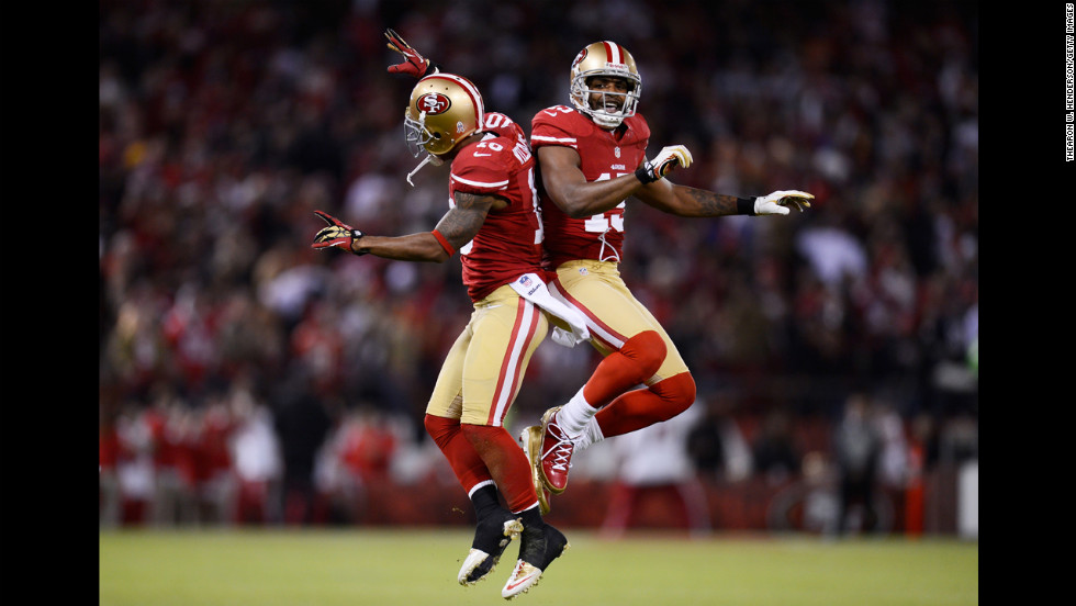 Kyle Williams, left, and  Michael Crabtree of the San Francisco 49ers celebrate a reception by Williams in the first quarter of Monday's game against the Chicago Bears.