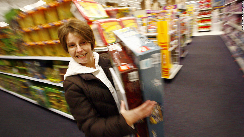 Racing through the isles of a Fort Worth, Texas, Toys'R'Us, Shawna Jones shops off her 2009 Black Friday list.