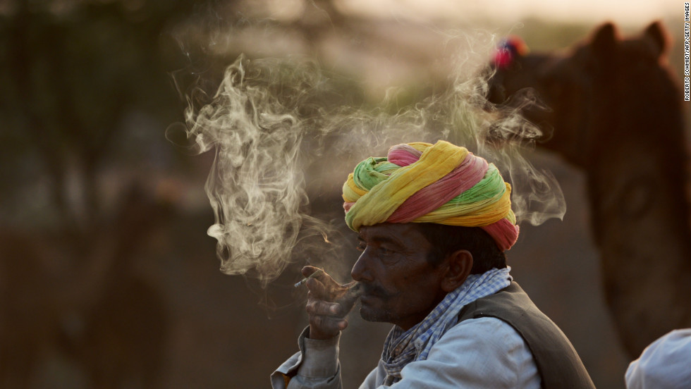 A camel trader smokes an Indian cigarrette called Bidi at the camel fairgrounds on Wednesday.