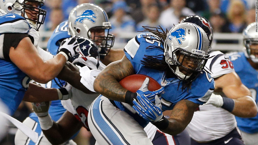 Mikel Leshoure of the Detroit Lions runs for a touchdown in the first quarter against the Houston Texans on Thursday at Ford Field in Detroit. The Texans won 34-31 in overtime.