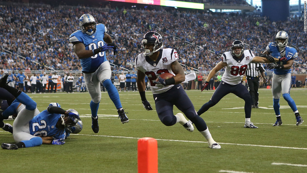 Arian Foster of the Houston Texans runs six yards for a touchdown in the second quarter against the Detroit Lions on Thursday.