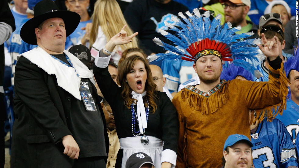 Fans dressed as pilgrims and Native Americans cheer during the Thanksgiving Day game between the Detroit Lions and the Houston Texans.