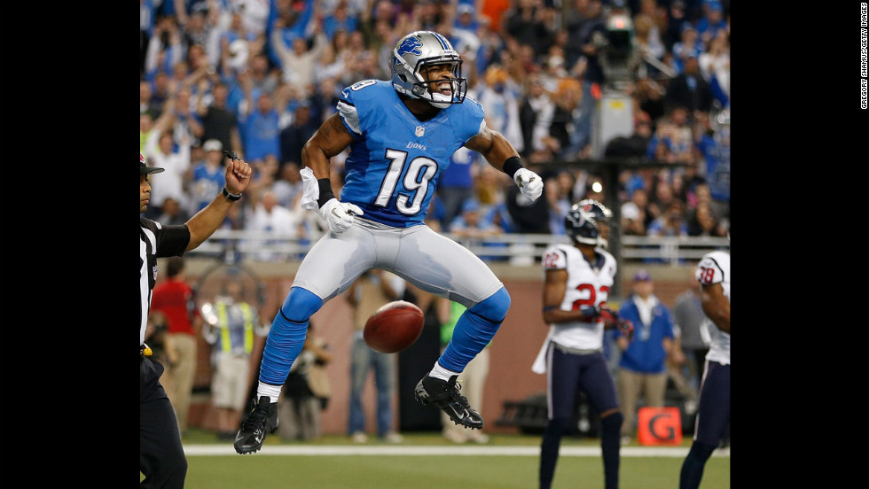 Mike Thomas of the Detroit Lions celebrates a touchdown in the second quarter against the Houston Texans.