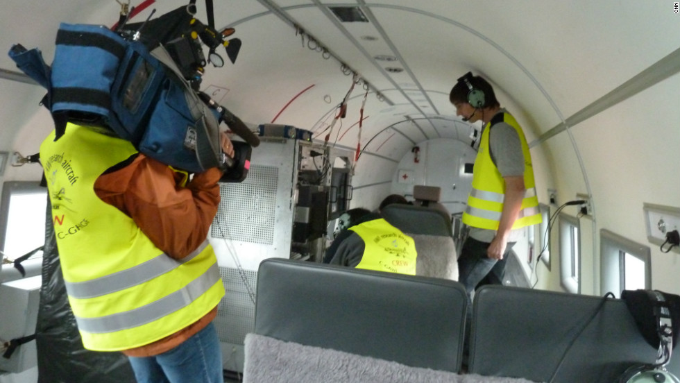 Geophysicist Daniel Steinhage, the head of the mission to Greenland, and his crew outfit the plane with state of the art computers. CNN camera woman Claudia Otto films the scientists.