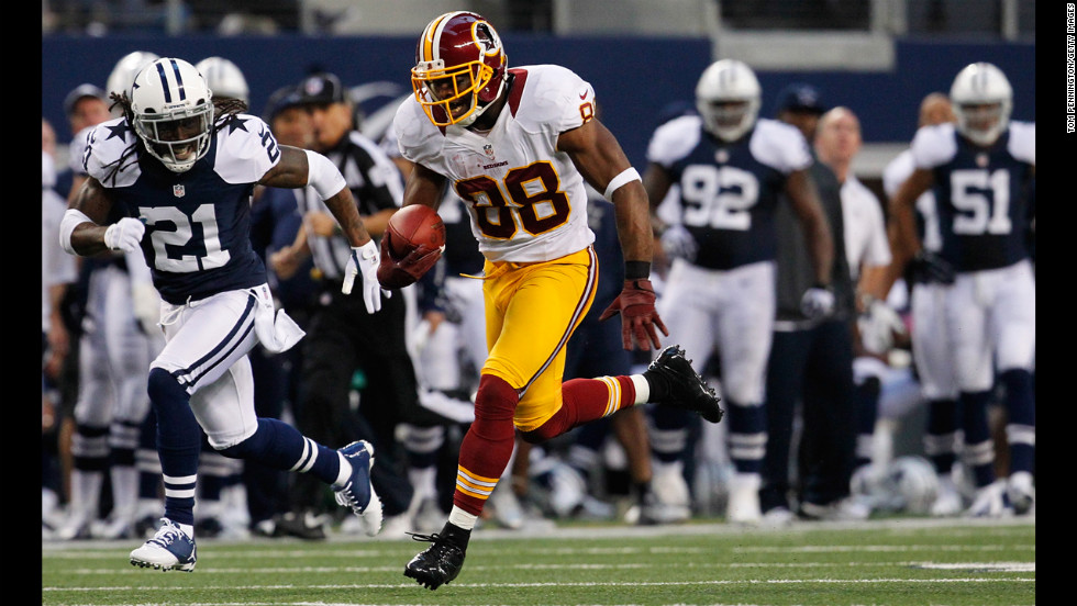 Pierre Garcon of the Redskins runs the ball for a touchdown against the Cowboys on Thursday.