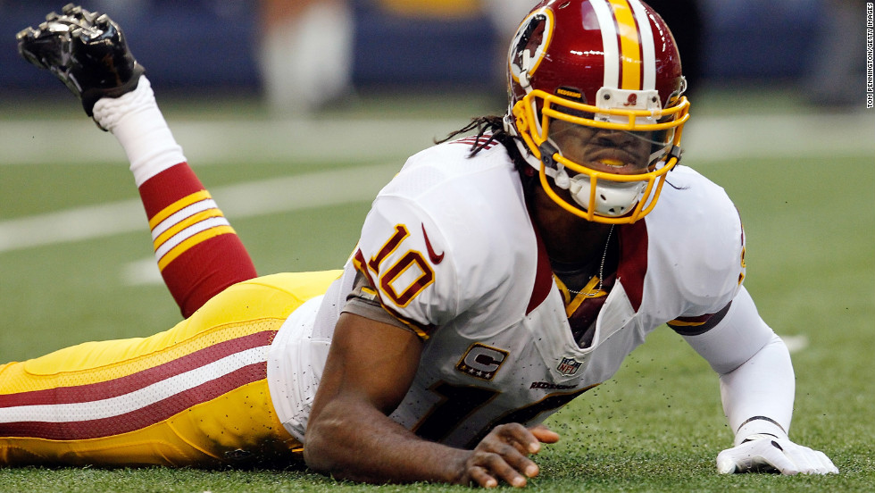 Robert Griffin III of the Washington Redskins reacts after being sacked Thursday by Jason Hatcher of the Dallas Cowboys.