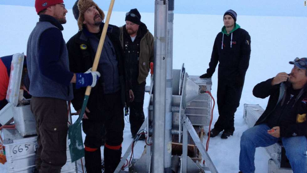 Scientists work the ice core drill in the middle of the inland ice.