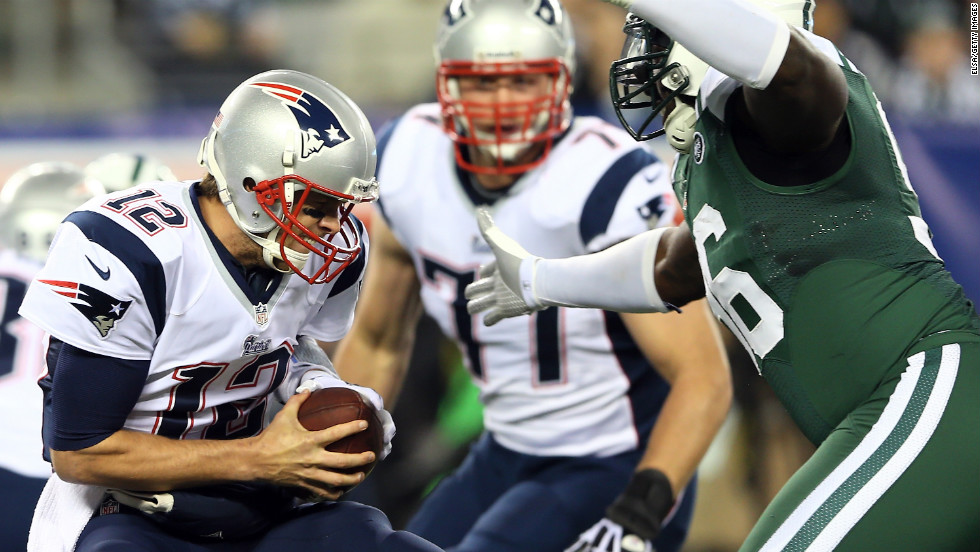 Quarterback Tom Brady of the New England Patriots braces as he is sacked by Muhammad Wilkerson of the New York Jets on Thursday, November 22, at MetLife Stadium in East Rutherford, New Jersey.