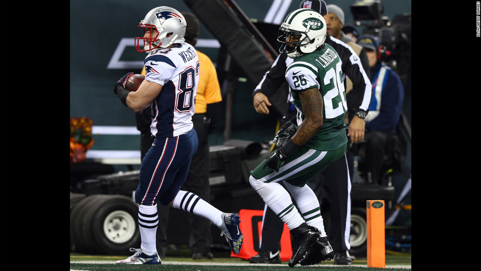 Wes Welker of the New England Patriots scores a touchdown past New York Jets defender Ellis Lankster.