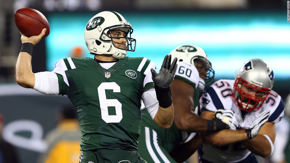 New York Jets quarterback Mark Sanchez drops back to pass in the second quarter against the New England Patriots.