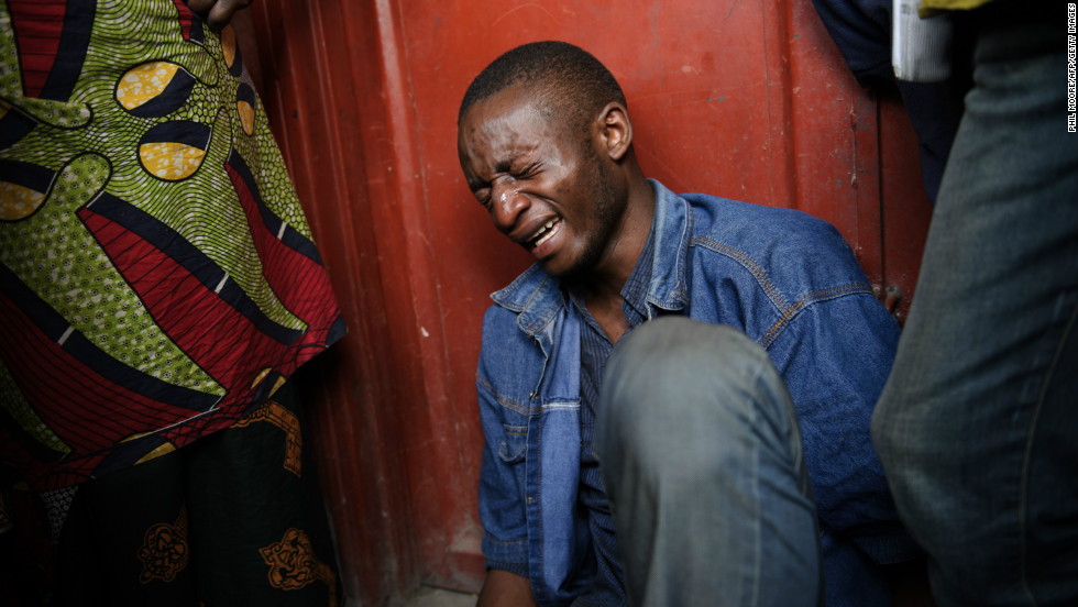 Lokuli Loleko Prince finds the body of his father in Goma on November 21, 2012. Loleko's father, a government military doctor, was killed in fighting between the government army and M23 rebels as they took the provincial capital.