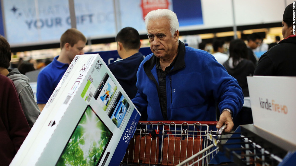 Shoppers move through a Best Buy store in Naples.