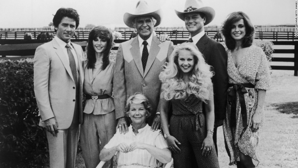 "A group portrait of the original cast of ""Dallas,"" clockwise from left: Patrick Duffy, Victoria Principal, Jim Davis, Charlene Tilton, Larry Hagman, Linda Gray and Barbara Bel Geddes. The series premiered in 1978 and ended in 1991."