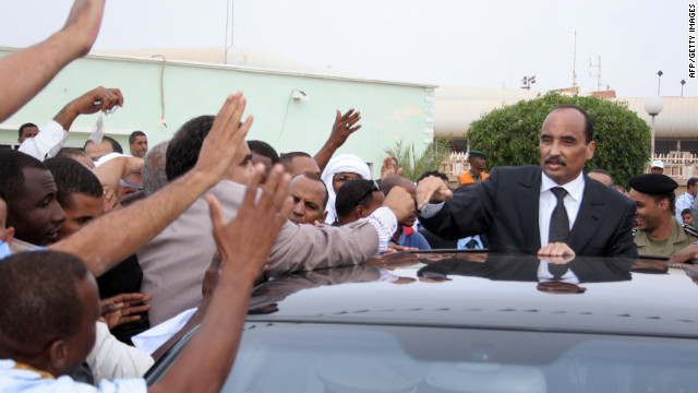 Mauritania's President Mohamed Ould Abdel Aziz greets the crowd at the airport as he returns home.