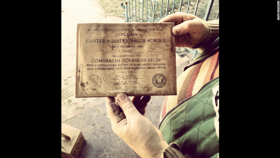 Residents and volunteers salvage what they can, including this high school diploma pulled from a flooded basement.