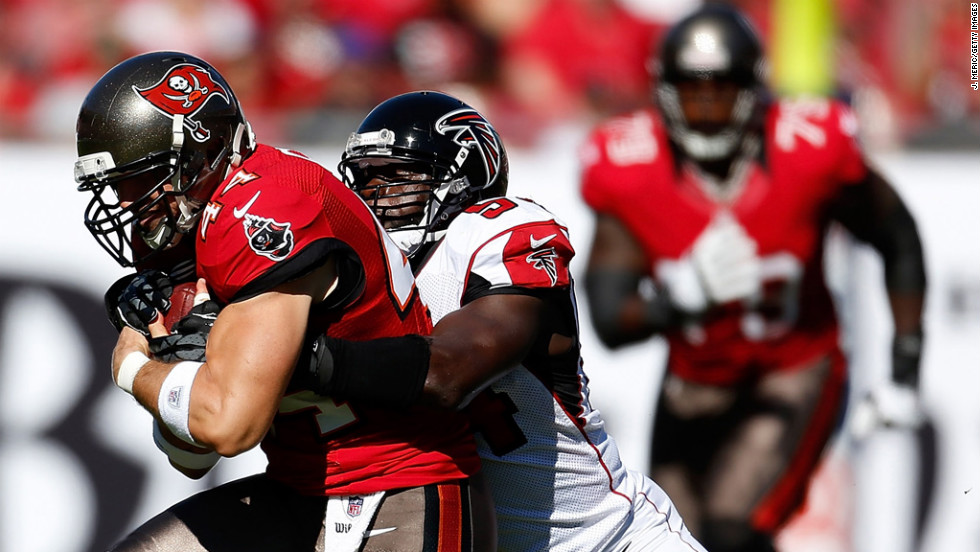 Tight end Dallas Clark of the Buccaneers is tackled by linebacker Stephen Nicholas of the Falcons on Sunday.