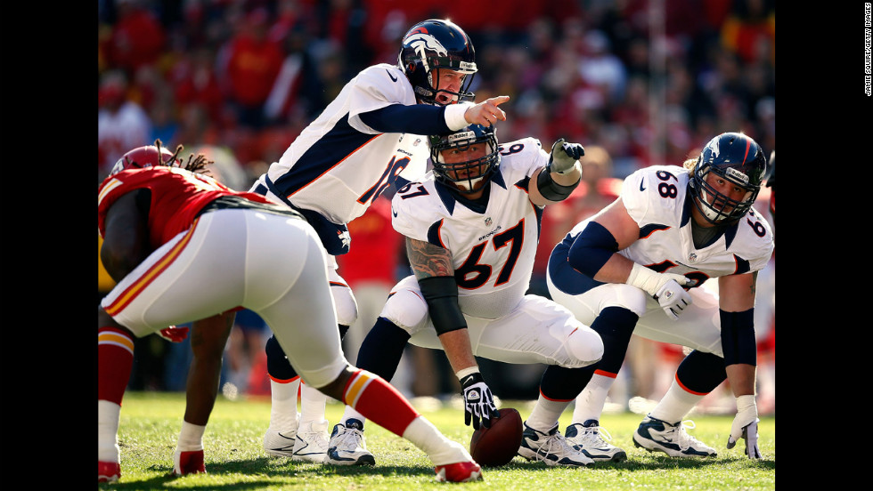 Quarterback Peyton Manning of the Broncos surveys the defense with center Dan Koppen during the game against the Chiefs on Sunday.