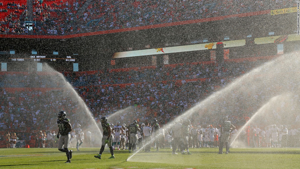 Sprinklers on the field go off during the game between the Dolphins and the Seahawks at Sun Life Stadium on Sunday in Miami Gardens, Florida.