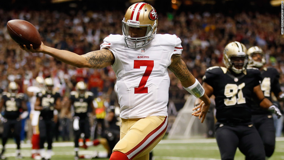 Quarterback Colin Kaepernick of the San Francisco 49ers celebrates after scoring a touchdown against the New Orleans Saints at The Mercedes-Benz Superdome in New Orleans on Sunday.