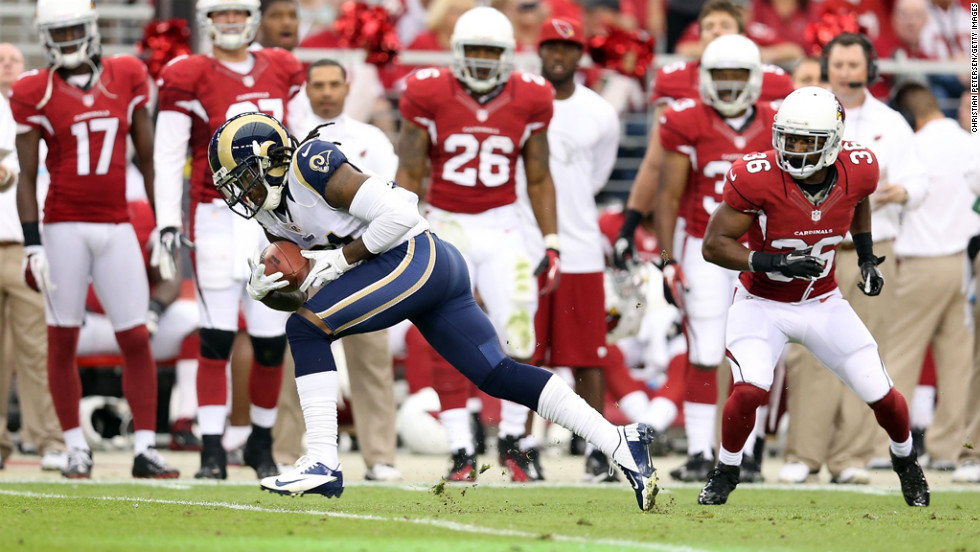 Cornerback Janoris Jenkins of the Rams returns a 36-yard touchdown interception past LaRod Stephens-Howling of the Cardinals during the second quarter on Sunday.