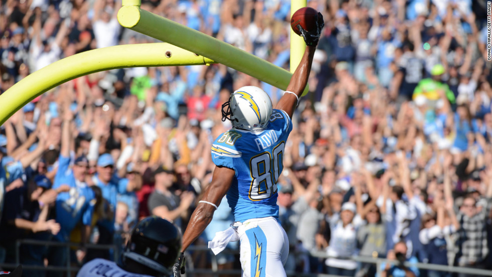 Wide receiver Malcom Floyd of the Chargers dunks the ball in the field goal uprights after scoring a touchdown against Ravens on Sunday.