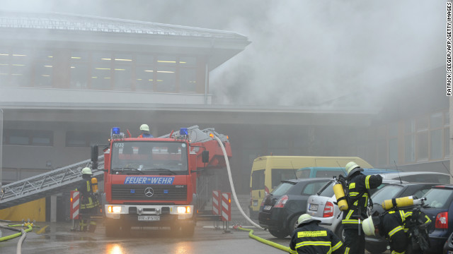 Firefighters stand in front of house with a workshop for handicapped people in Titisee- Neustadt on November 26, 2012.
