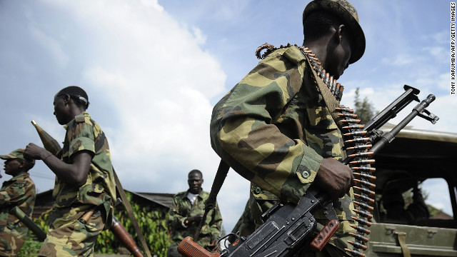 M23 rebel soldiers stand guard at the former Congolese army headquarters in Goma, on November 23, 2012, after it was abandoned by fleeing Congolese army soldiers.