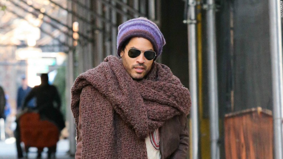Lenny Kravitz strolls the streets of New York with an extra-long scarf to protect him from the chilly weather on November 23.