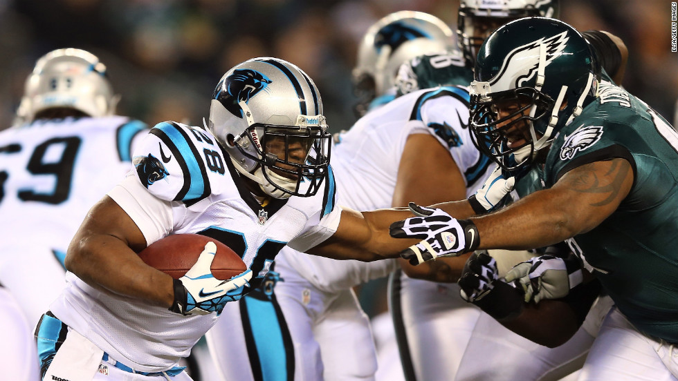 "Jonathan Stewart of the Carolina Panthers carries the ball as Cullen Jenkins of the Philadelphia Eagles defends on Monday, November 26, at Lincoln Financial Field in Philadelphia. Check out the action from Week 12 of the NFL and <a href=""http://www.cnn.com/2012/11/16/worldsport/gallery/nfl-week-11/index.html"">look back at the best photos from Week 11</a>."