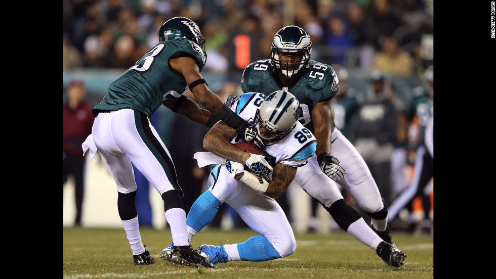 Panthers wide receiver Steve Smith  catches the ball between defenders Dominique Rodgers-Cromartie, left, and DeMeco Ryans of the Philadelphia Eagles.