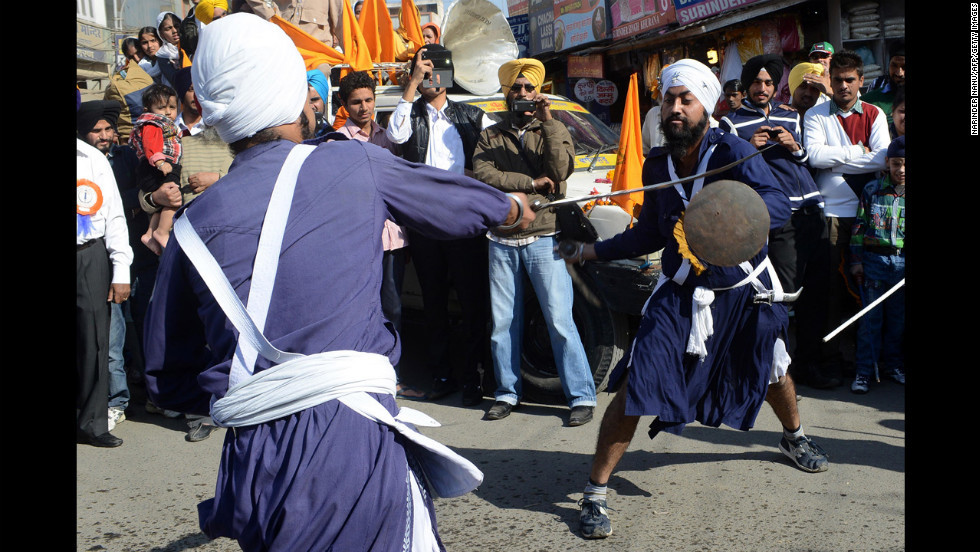 Indian Sikh Nihangs, or warriors, demonstrate their gatka skills during a procession from Sri Akal Takhat to the Golden Temple in Amritsar on Tuesday.