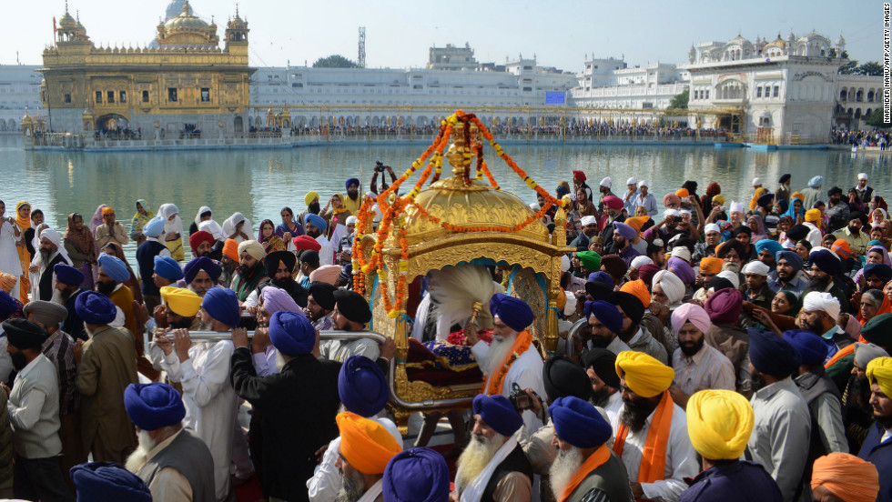 Indian Sikh devotees carry the Palki Sahib, a Sikh holy book, during Tuesday's procession.