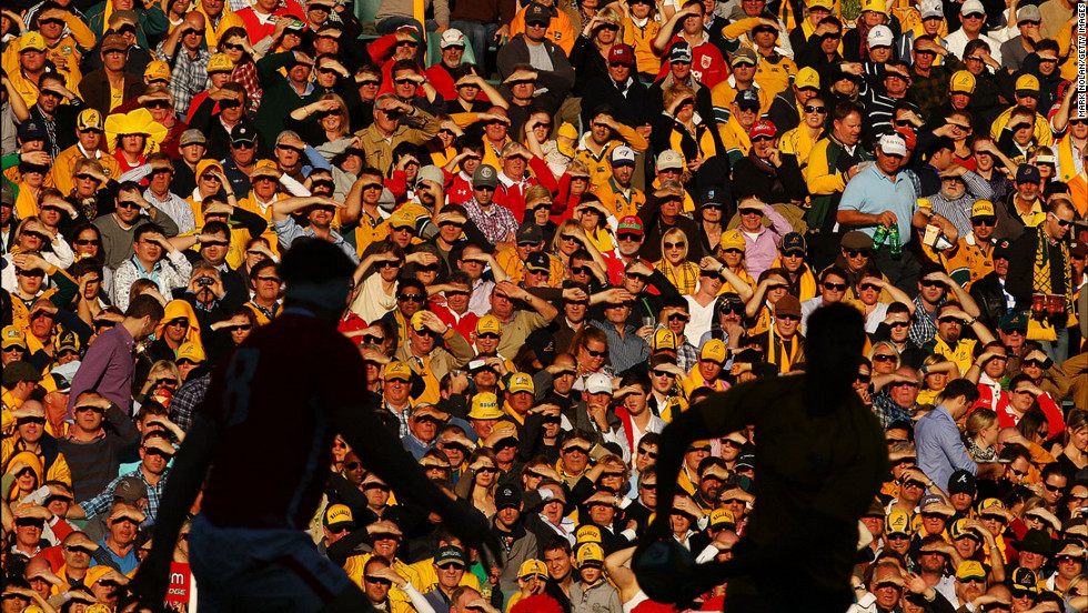Fans watch from the stands as Kurtley Beale of the Australian Wallabies looks to pass during the International Rugby Test match against Wales on June 23 in Sydney, Australia.