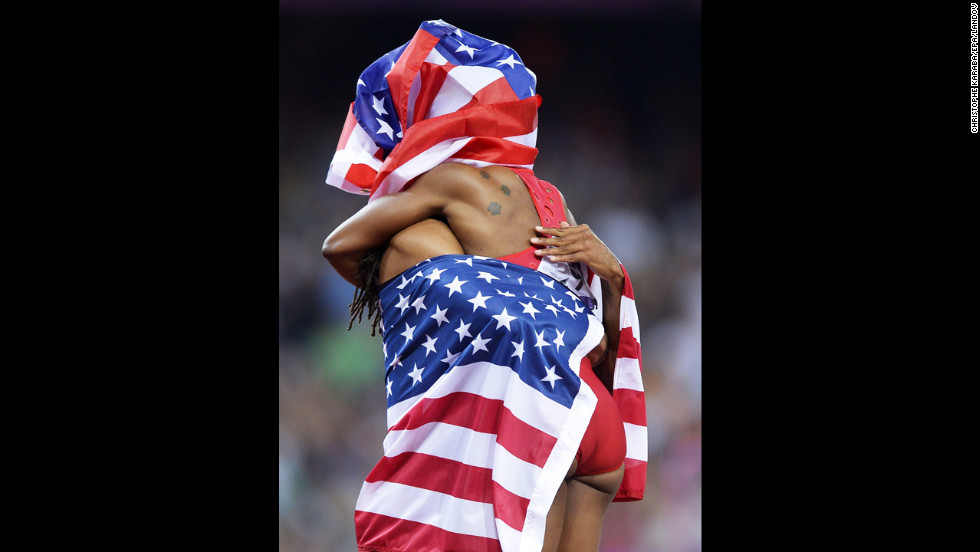 Jason Richardson, left, and Carmelita Jeter celebrate after placing third in the women's 200-meter and men's 110-meter finals at the London 2012 Olympics on August 8.