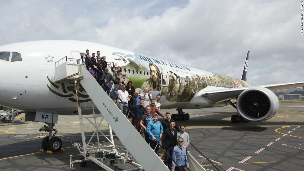 "The cast of ""The Hobbit"" pose with an Air New Zealand Hobbit-inspired jet after arriving in Wellington."